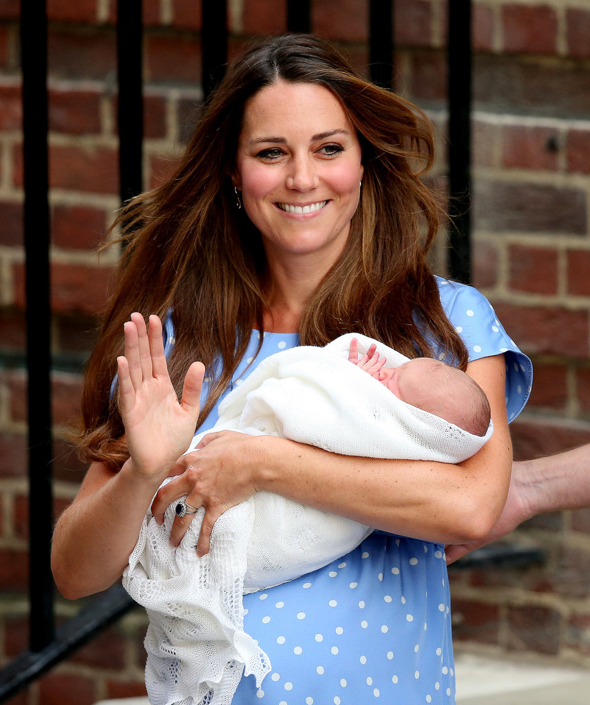 Kate Middleton waved with the royal baby in her arms as they left St. Mary's Hospital in London.