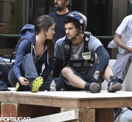 Taylor Lautner and Marie Avgeropoulos shared a moment on the set of Tracers on Sunday in NYC.