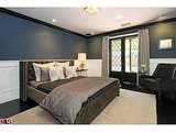 White wainscoting allows for a darker paint for the rest of the room.