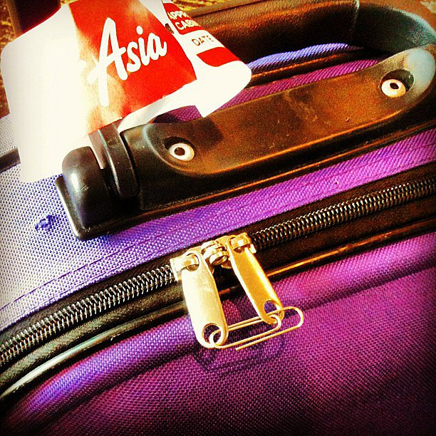 Use a Paper Clip as a Luggage Lock