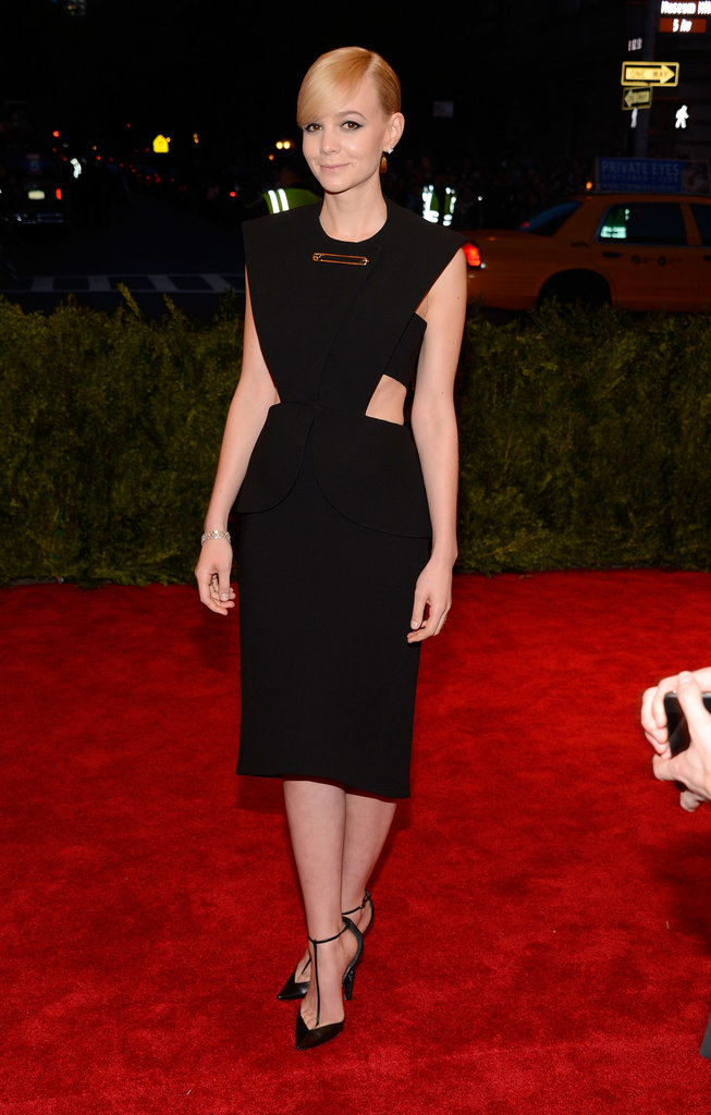 If you recall, Carey Mulligan chose a cut-out LBD from Alexander Wang's debut collection for Balenciaga for the 2013 Met Gala in NYC. The safety pin design totally fit the night's theme — Punk: Chaos to Couture.