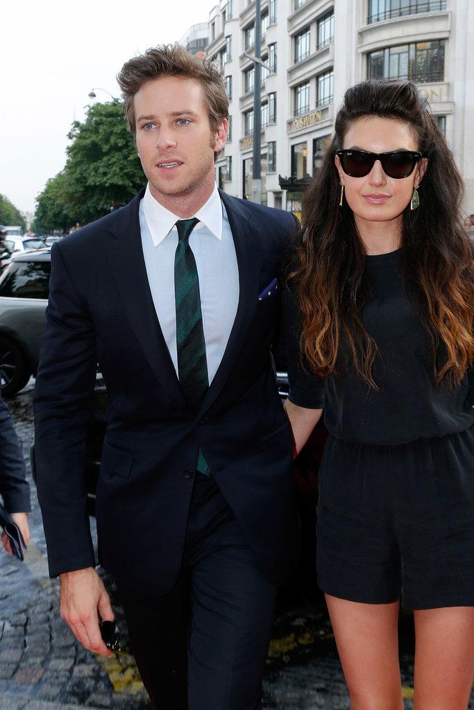 Armie Hammer and Elizabeth Chambers walked onto the Paris Lone Ranger red carpet in chic style.