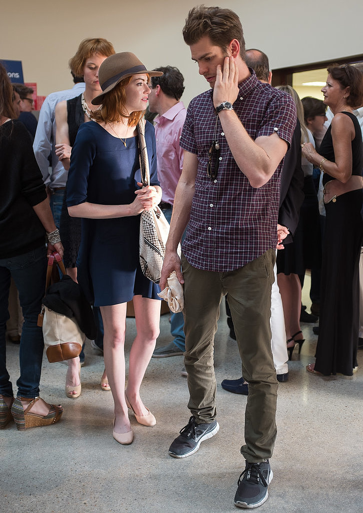 Cute couple Emma Stone and Andrew Garfield played coy when they were spotted outside Woody Allen's jazz concert in Antibes, France on July 21.