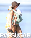 Gisele Bündchen carried baby Vivian in a body harness.