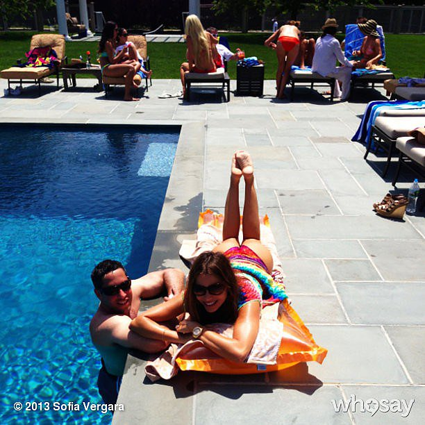 Sofia Vergara tanned by the pool with her fiancé, Nick Loeb.  Source: Sofia Vergara on WhoSay