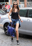 Miranda Kerr put her long legs on display in jean shorts.