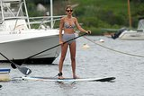 During a getaway to Rhode Island, Taylor Swift exuded vintage glamour in a black and white striped Topshop bikini.