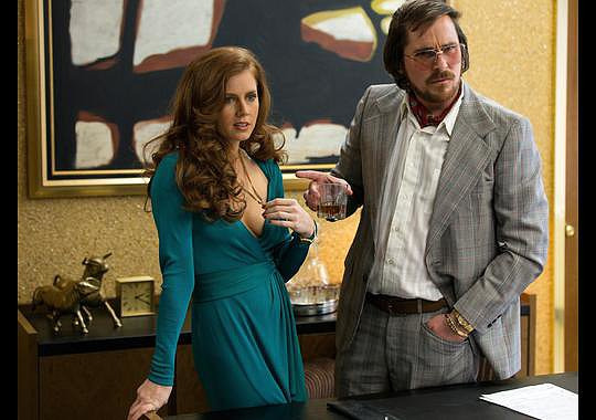 Amy Adams and Christian Bale in American Hustle.