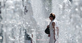A woman walked through a fountain during a hot day in Strasbourg, France.