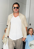 Brad Pitt held onto his twins' hands.
