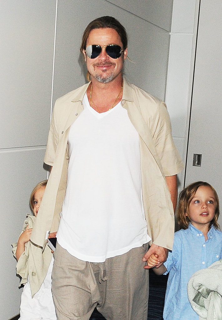 Brad Pitt held onto Knox and Vivienne's hands during a July 2013 outing in Tokyo, Japan.