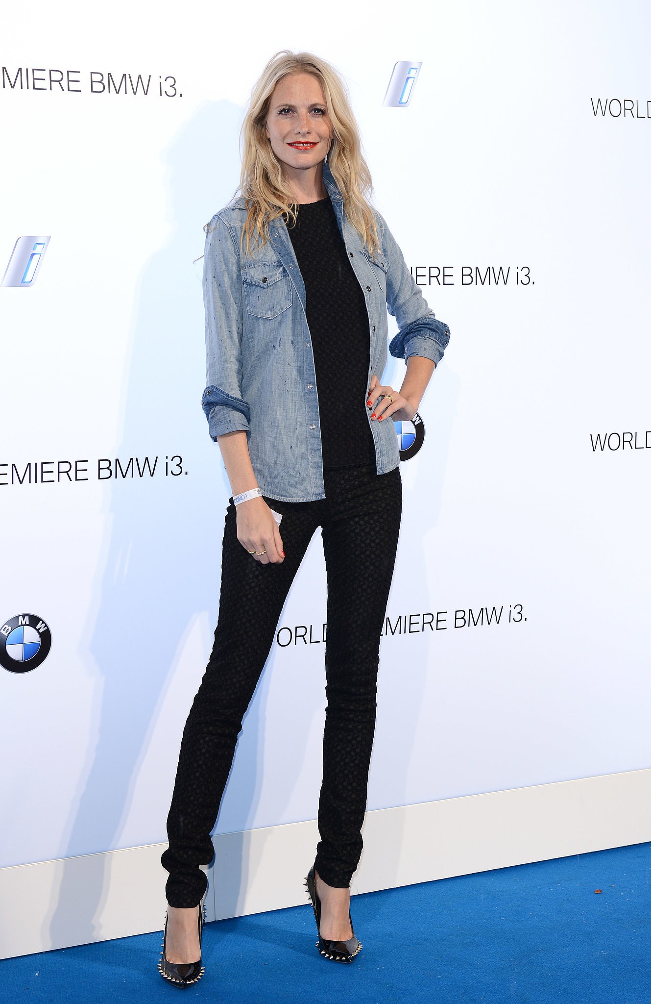 Poppy Delevingne looked cool and casual at the reveal for the BMW i3 in a slim black ensemble that she topped with a denim button-down.