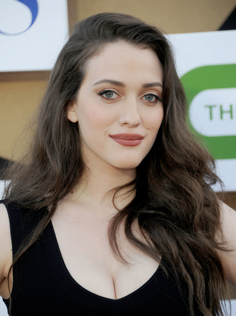 Beth's costar Kat Dennings went for a neutral palette with a champagne shadow that was paired with a taupe lipstick to play up her alabaster complexion.