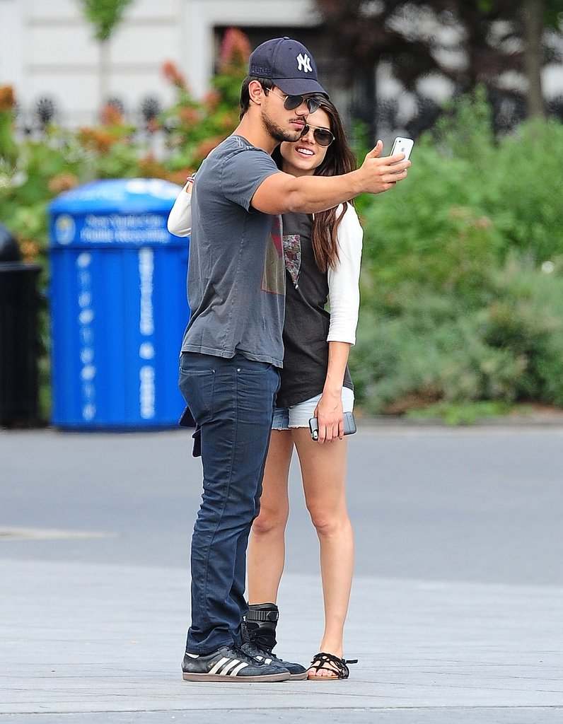 Taylor Lautner took a photo of himself with new girlfriend Marie Avgeropoulos in NYC in July.