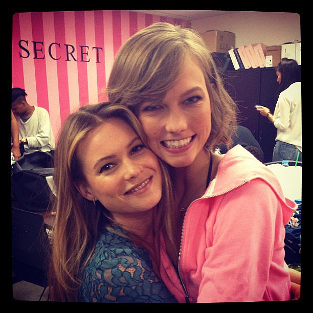 Karlie Kloss snuggled up to her newly engaged fellow Angel, Behati Prinsloo, during a Victoria's Secret promo event. Source: Instagram user victoriassecret