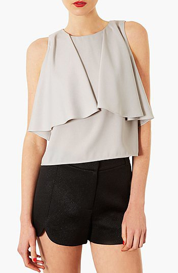 Silky blouses are beautiful, but we love one with a little something special. The draped front on this Topshop pick ($4