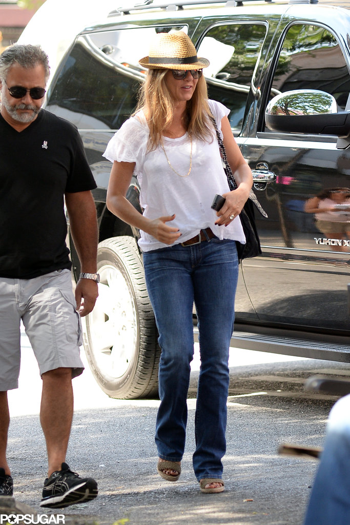 Jennifer Aniston wore a white t-shirt and jeans in NYC on July 31.