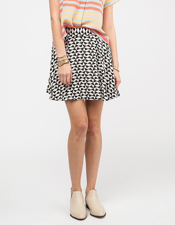 Style a loose printed skirt ($48) seriously with a silky white button-down.