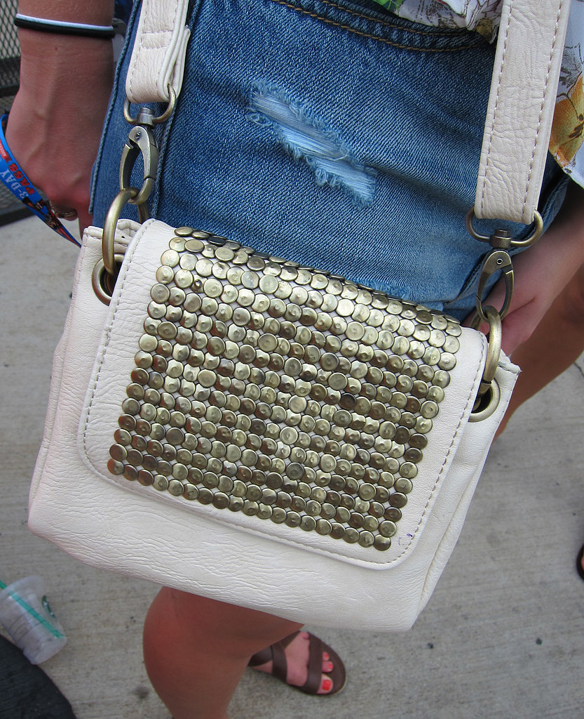 No weekend bag is complete without a little embellishment, right? We like the way the dusty gold studs covering this cream Urban Outfitters purse add texture without trying too hard.