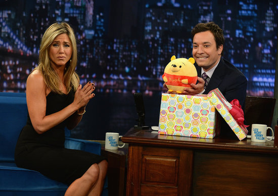Jennifer Aniston gave Jimmy Fallon a Winnie the Pooh bear for his new daughter.