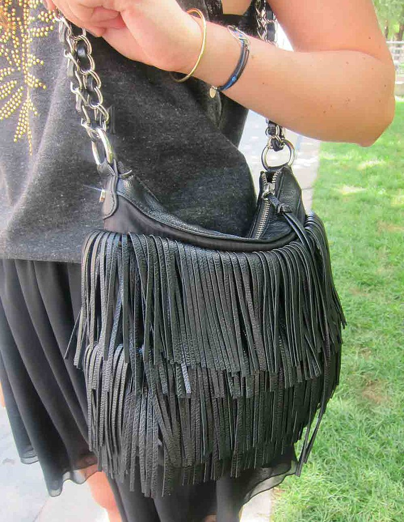 Fringe benefits: we love the layers upon layers of fringed leather on this black purse.