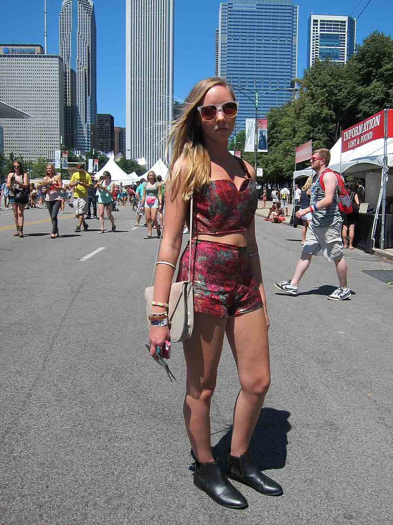 If you can't find a festival look that's right for you, just make it! Deanna, in frost-framed Akira sunglasses, took apart a vintage dress and designed her own printed crop top and shorts.