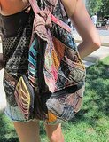 When you can't decide on a color, just go with all of them, as this Lollapalooza attendee did with her backpack.