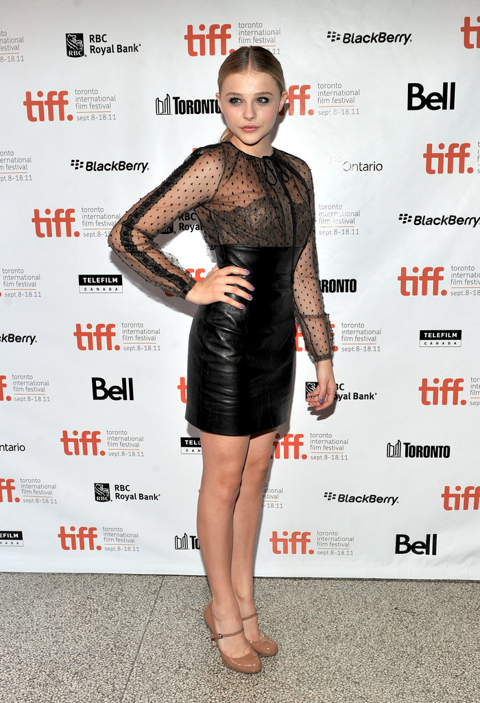 Mixing demure lace with edgy leather, Chloë brought the drama to the Hick premiere in Valentino.