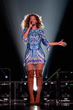 Beyoncé channeled a boho-goddess vibe in a fringed minidress and thigh-high lace-up boots.