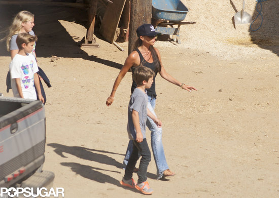 Victoria Beckham walked with her sons.