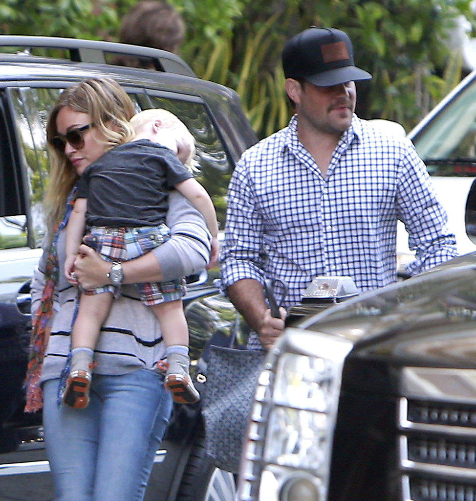 Hilary Duff carried her sleepy son, Luca, around in LA on Sunday.