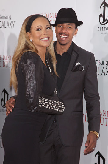Mariah Carey wore a studded cast while walking the red carpet with Nick Cannon.