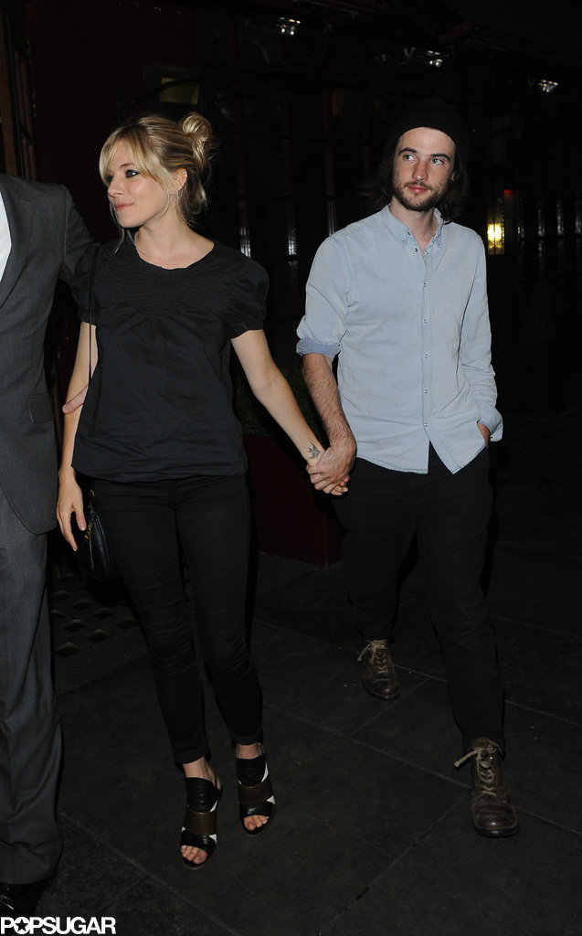 Sienna Miller and Tom Sturridge held hands for a dinner date at J Sheekey restaurant in London.