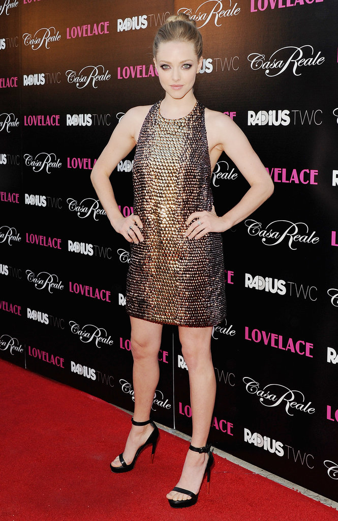 Amanda hit the Hollywood premiere in a hot bronze, embroidered, snake-effect Gucci minidress and completed the look with subtle but sexy ankle-strap sandals.