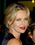 Charlize donned a satiny red lipstick and shimmery brown eyes for the premiere of In the Valley of Elah in 2007. She kept some wispy pieces around her face for a casually sexy look.