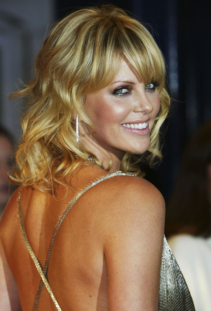 Charlize paired her sweet curls with a sexy metallic smoky eye at the French premiere of The Italian Job in 2003.