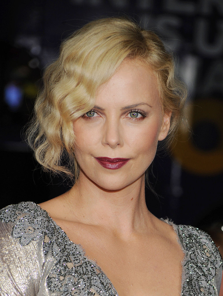 Charlize nailed another lipstick look with a glossy wine hue at a screening for The Road in 2009. She paired her vixen lips with peachy cheeks and a twisted updo for an extra shot of glamour.