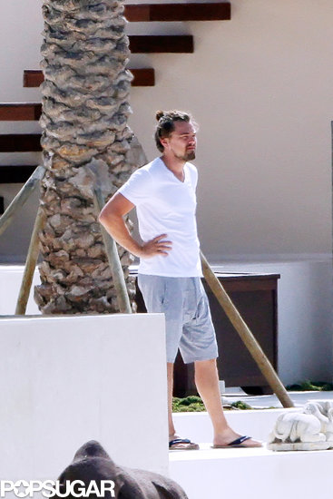 Leonardo DiCaprio wore his hair in a bun in Ibiza.