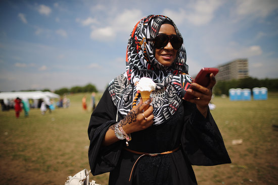 A woman in London, England, enjoyed ice cream during an Eid celebration at Burgess Park.