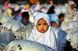 A child looked up during a special Eid al-Fitr morning prayer in Bali.