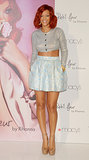 For the Lakewood, CA, launch of her Reb'l Fleur perfume, Rihanna took a sweet turn in a shimmering cropped cardigan, baby-blue jacquard skirt, and nude ankle-strap platforms.
