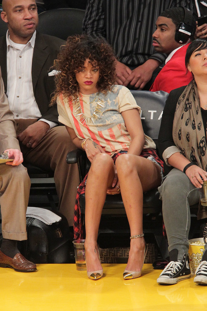 Rihanna cheered on the LA Lakers working an American flag tee, denim cutoffs, and plaid flannel in January 2012.