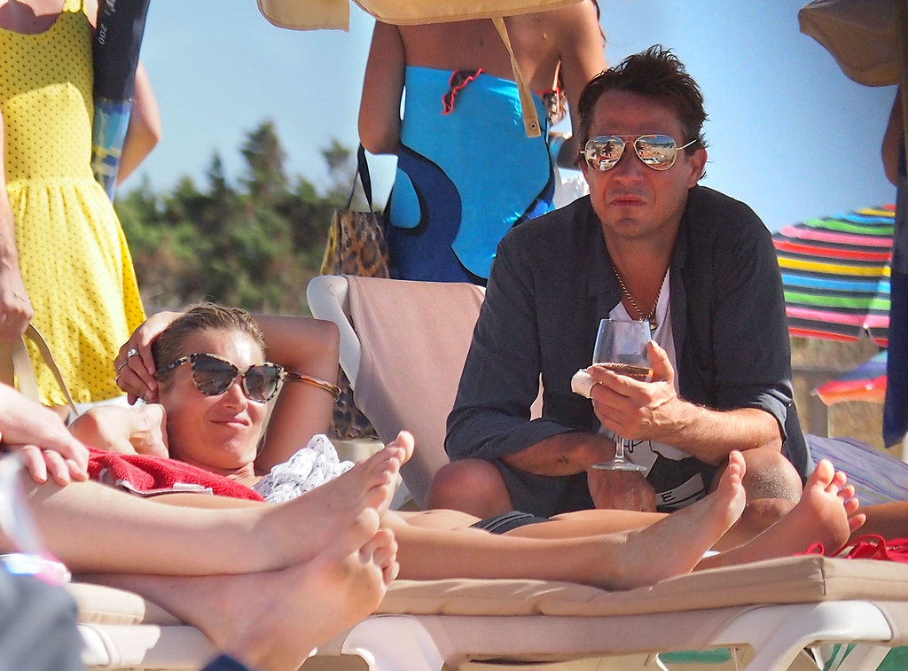 Kate Moss and Jamie Hince laid out on a pair of chaises.