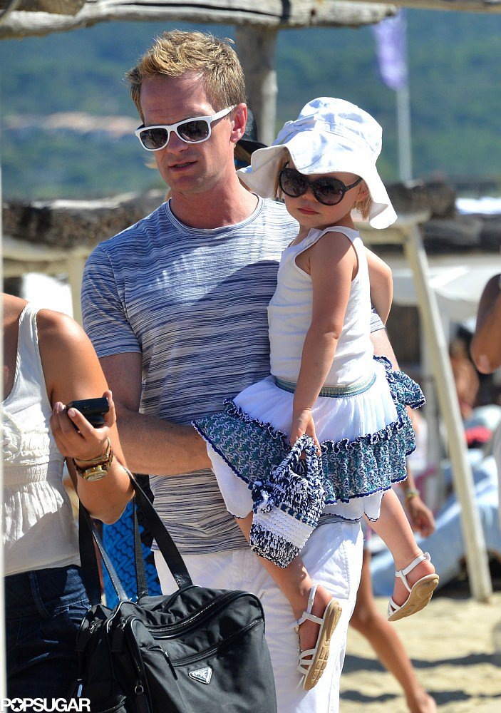 Neil Patrick Harris carried his daughter, Harper, on the beach in Saint-Tropez.