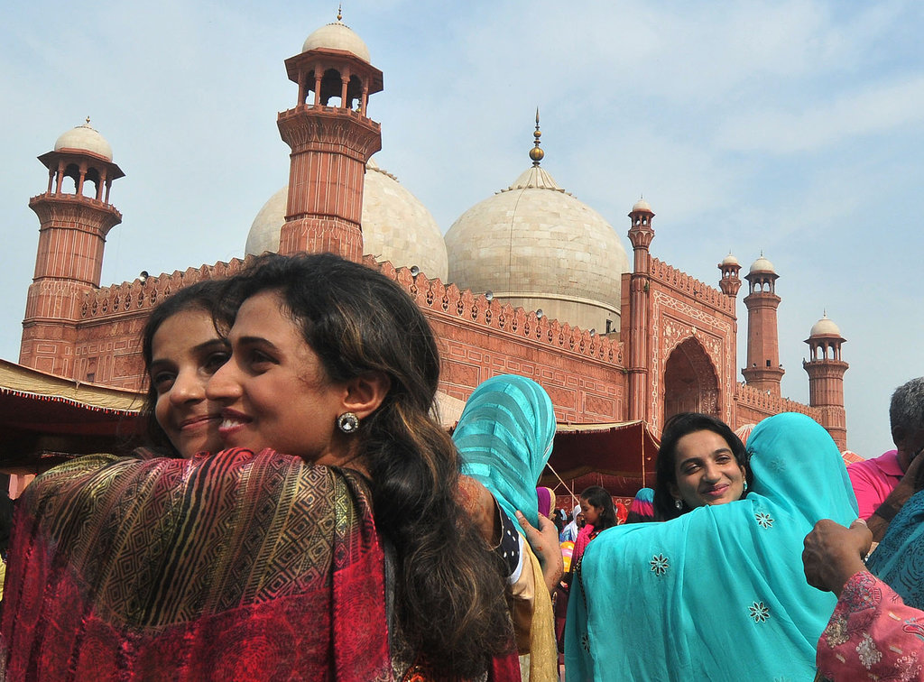 Pakistani women greeted each other after the Eid al-Fitr celebrations in Lahore.