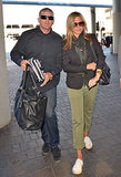 Jennifer Aniston wore an All Saints scarf while making her way through LAX.