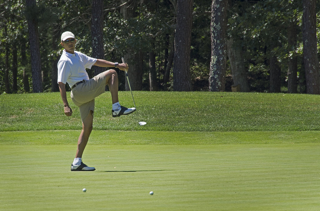 The president wasn't so excited to miss his putt.