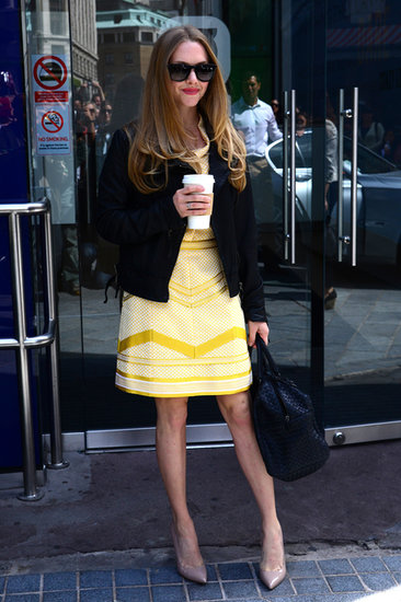 The actress added edge to a pretty yellow dress with a tough-girl moto jacket while promoting the film in the UK.
