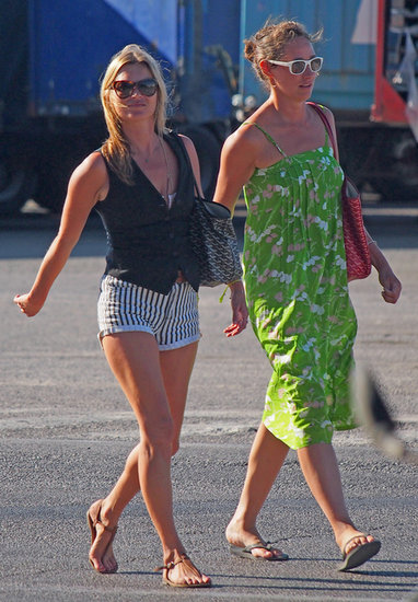 While vacationing in Spain, Kate Moss showed off a familiar combo: that black vest and striped shorts.