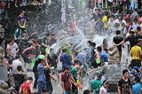 People splashed water on each other in Baoting, China, during the Hainan Qixian Hotspring Water Festival.